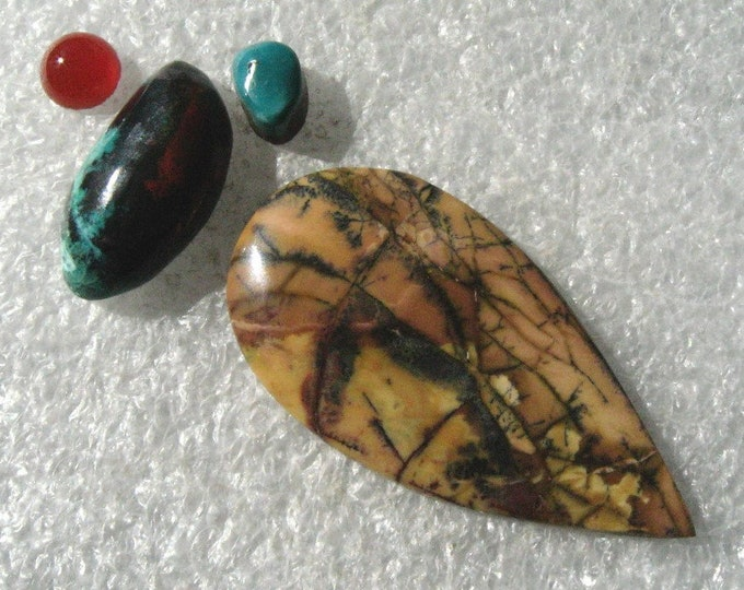 Group with Yellow Feather Jasper Cabochon