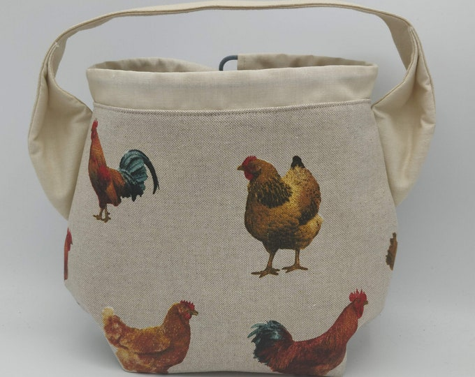 Ears Project bag with a chicken theme for knitters, closes with a drawstring and is fully lined