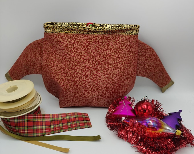 Project bag shaped like a Christmas sweater with quirky sleeves, closes with a drawstring and is fully lined