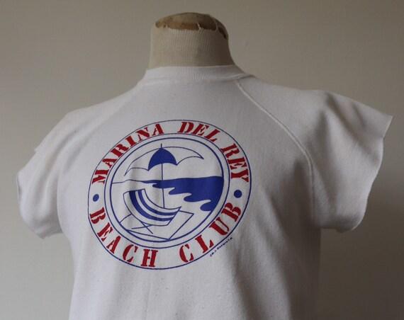 "Vintage 1980s 80s white cut off raglan sleeve sweatshirt Marina Del Rey 42"" chest"