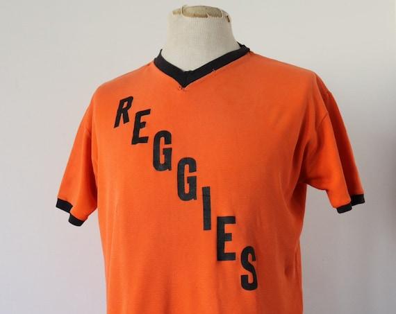 "Vintage 1970s 70s cotton nylon orange black Reggie British football top sportswear sports t shirt 44"" chest v neck uniform"