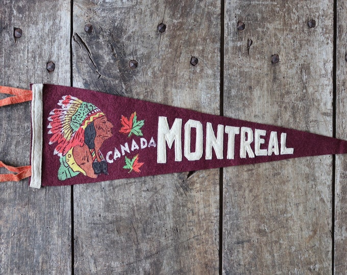 Featured listing image: Vintage 1960s 60s burgundy red felt pennant flag tourist souvenir Canada Canadian Indian Chief head Montreal wall decor shop retail display