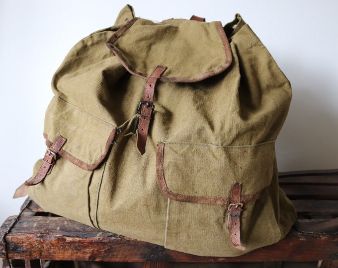 Featured listing image: Vintage 1940s 40s french large khaki green cotton canvas leather rucksack backpack bag hiking walking camping