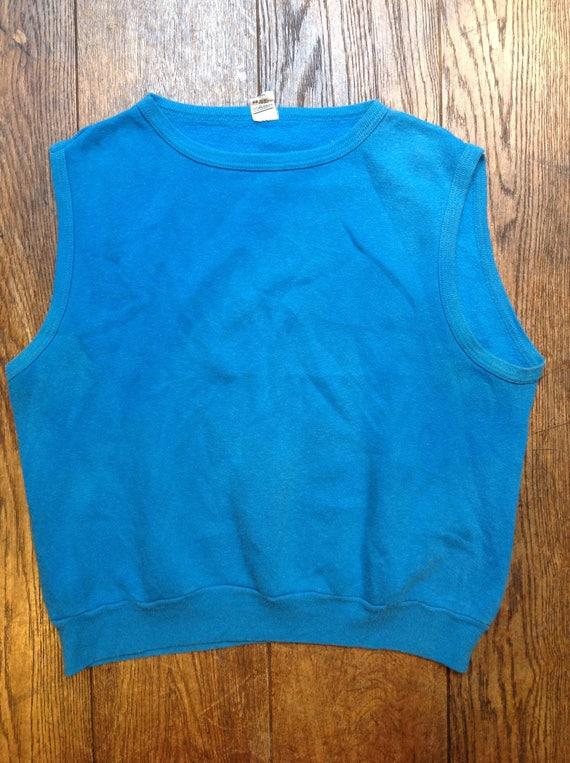 "Vintage 1980s 80s plain turquoise blue cut off sleeveless sweatshirt printed 44"" chest sportswear warm up top"