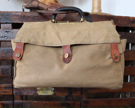 Vintage 1930s 30s 1940s 40s brown leather Gladstone bag with canvas security cover military