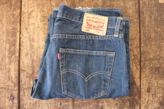 "Vintage Levis Strauss indigo blue denim 501 jeans 33"" x 34"" workwear button fly small e red tab"
