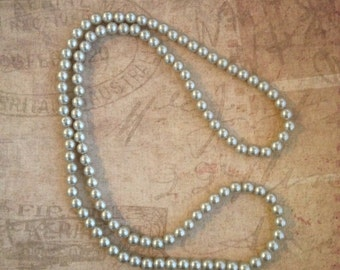 Long Strand Pearl Necklace