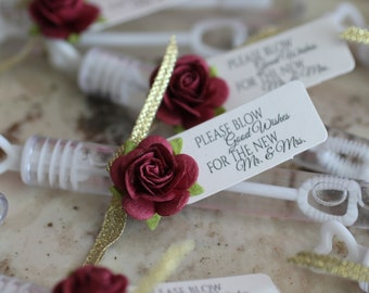 ASSEMBLED wedding bubbles with burgundy roses, bubble send off, bubble wands, burgundy and gold wedding details, wedding send off