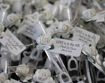 ASSEMBLED wedding bubbles, bubble send off, bubble wands, wedding details, white roses, love is in the air
