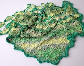 crocheted shawl in greens...