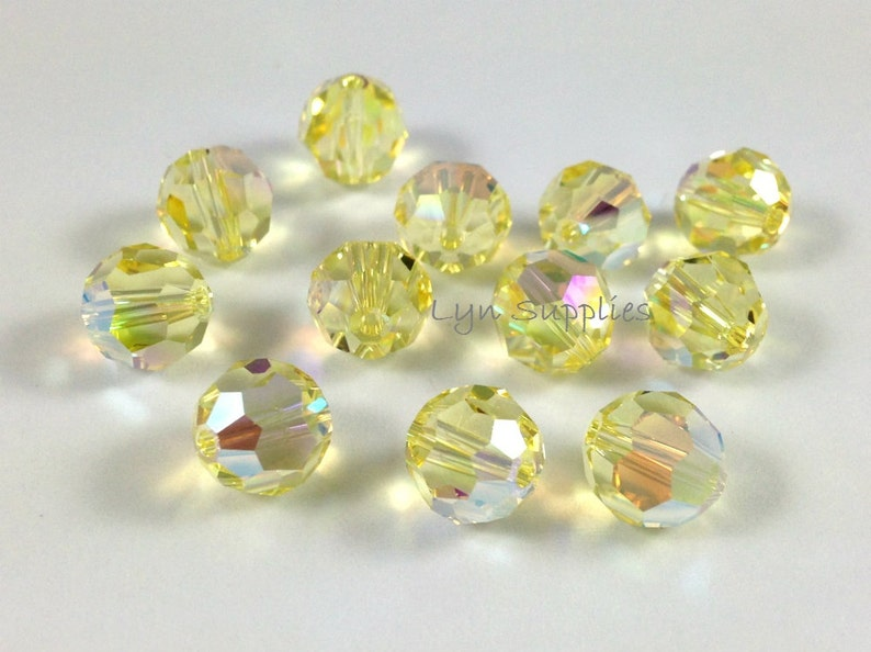573d5f135ded6 24pcs 6mm JONQUIL AB 5000 Swarovski Crystal Faceted Round Beads