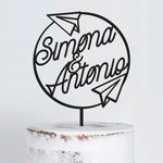 Travel theme wedding cake topper with airplanes customizable with the names of bride and groom
