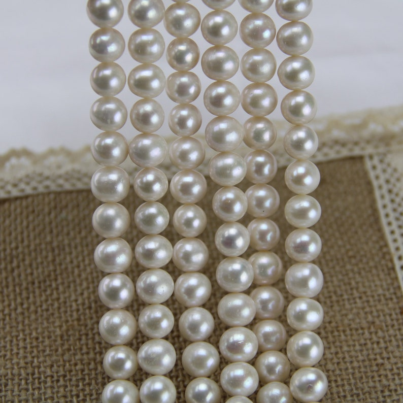 9mm AA ivory white potato pearl strand,near round freshwater pearl bead string wholesale China,real pearl necklace material finding supply