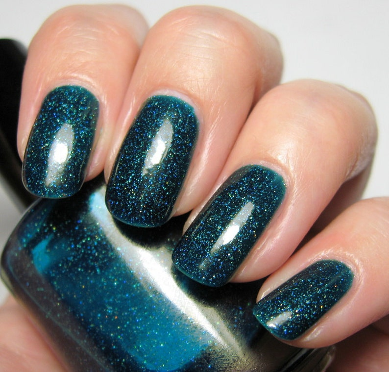 Confusion  15 ml  teal jelly polish with holographic image 0