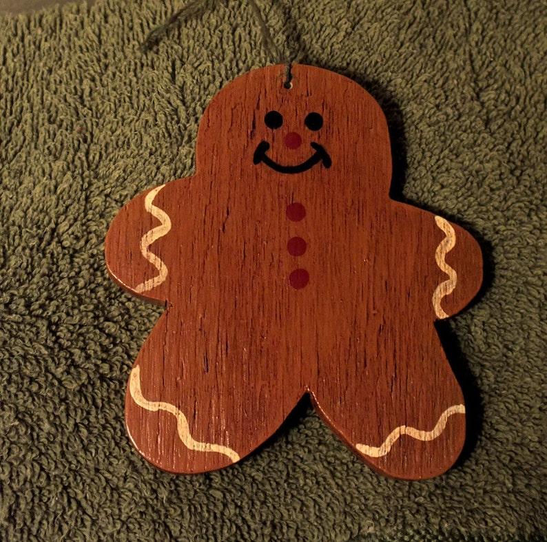 Folk Art Gingerbread Man Ornament On Painted Wood