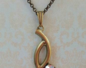 FERRERA– Swarovski SS29 Rose AB necklace in oxidized brass setting