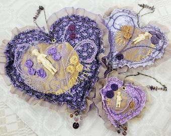 """Gilt """"Frozen Charlotte"""" Purple Heart Ornaments Trio"""