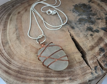 Welsh seaglass pendant. Copper wire wrapped welsh light grey/off white frosty seaglass. Sterling chain.