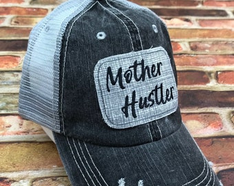 fc3b1f6983711 Mother Hustler Embroidered Grey and White Hatched Raggy Patch Distressed  Black and Grey Trucker Hat or Messy Bun   High Ponytail Cap