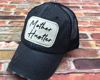 8fad5b3172ab1 Mother Hustler Embroidered Glitter Golf Raggy Patch Distressed Black Trucker  Hat Or Messy Bun   High Ponytail Cap