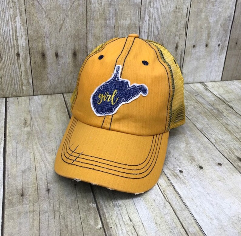 e84b8af11 West Virginia Girl / Home State of West Virginia Embroidered Blue Raggy  Patch Distressed Gold and Blue Trucker Hat / Baseball Cap