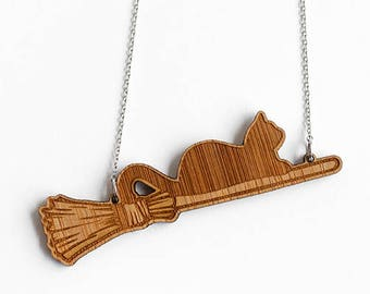 Cat on a broomstick necklace - handmade from eco-friendly bamboo wood