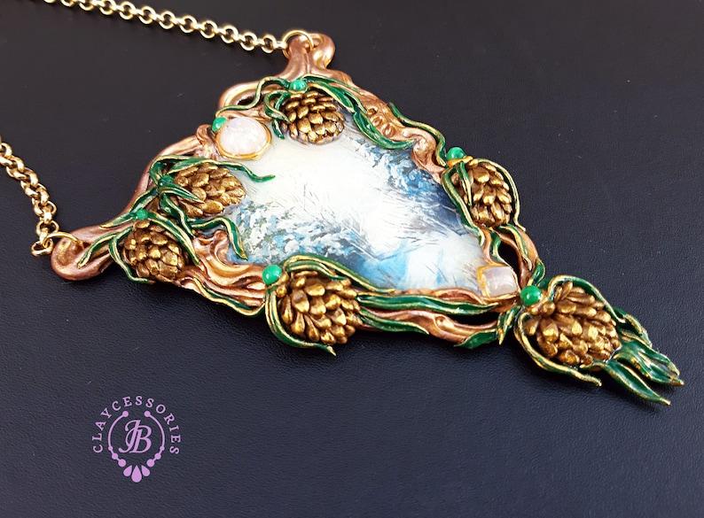 Art Nouveau Christmas Pine cone necklace Winter landscape image 0