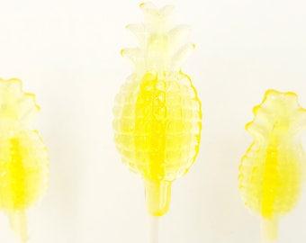 Pineapple lollipops. Lollipops. sweet treats. pineapple pops. Candy lollipops. pineapple lollipops. pineapple party. pineapple treats.