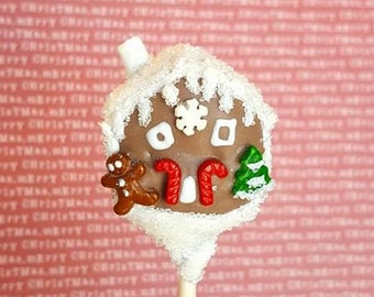 Gingerbread house cake pops. Stocking treats. Christmas treats. Christmas cake pop. Christmas party decor. Tree pop. Snow globe. Gingerbread