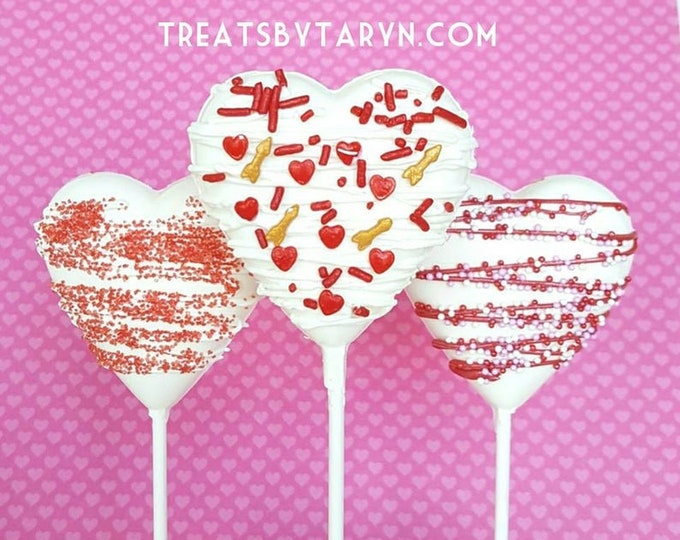 Featured listing image: Valentine heart lollipops. heart lollipops. valentine's day treats. valentine's lollipops. kids treats. chocolate. chocolate lollipops.