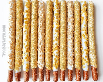 Chocolate Covered Pretzels. Gold pretzels. Gold and white pretzels. baby spritz pretzel rods. Gold and white rods. Gold pretzels. Gold treat