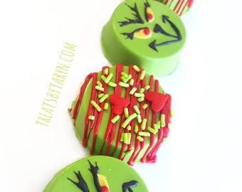 Christmas chocolate covered oreos. Xmas oreos. Red and green treats. Christmas cookies. Xmas cookies. Chocolate covered oreos.