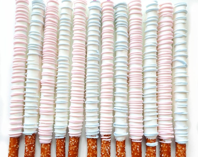 Chocolate Covered Pretzels. baby blue and white pretzels. Gender reveal pretzels. baby spritz pretzel rods. baby blue and pink rods