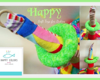 Happy! The tower to play with donuts to tuck. Handmade cloth toy with fabric Nicki and Chenille