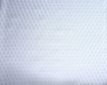 """Lacey White Sheer Stretch Fabric.  60"""" wide and sold by the yard"""