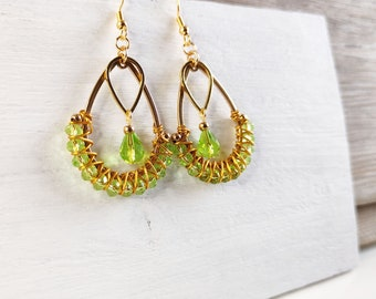 Green crystal beaded earrings woven in the manner of golden creole drop