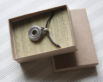Recycled Open Hole Flute Key Silver Circle Pendant