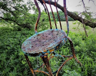 a chair worthy of hanging as art...French Country Metal Bistro Chair...wonderful, multi-colored chippy paint...Photo Prop Extraordinaire...