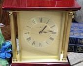 Howard Miller Model 645-591 Rosewood and Brass Pillar Mantle Clock
