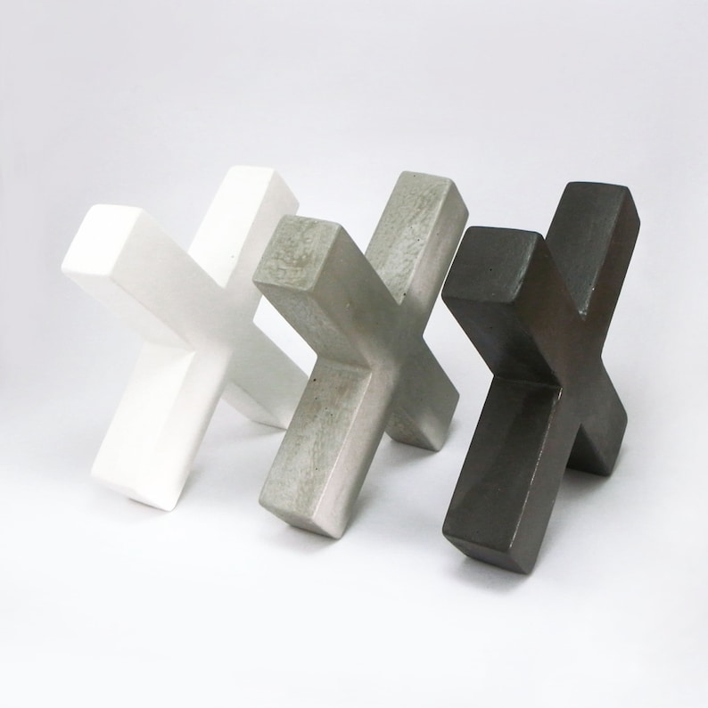 Concrete bookends in the shape of a letter X image 0