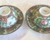 A Pair of 19th Century Chinese Export Famille Rose Cup and Saucer with Landscape Reserve Panel.