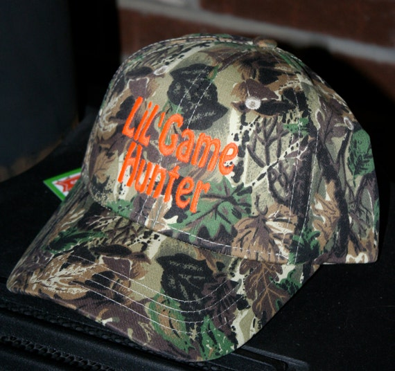 ONE camo hat. You CUSTOMIZE the name/saying on the cap. Adult & Youth size available. Embroider will be in bright neon hunter orange.