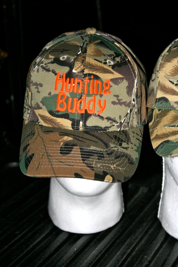 2bcbb4744f8 ONE camo hat. You CUSTOMIZE the name saying on the cap. Adult