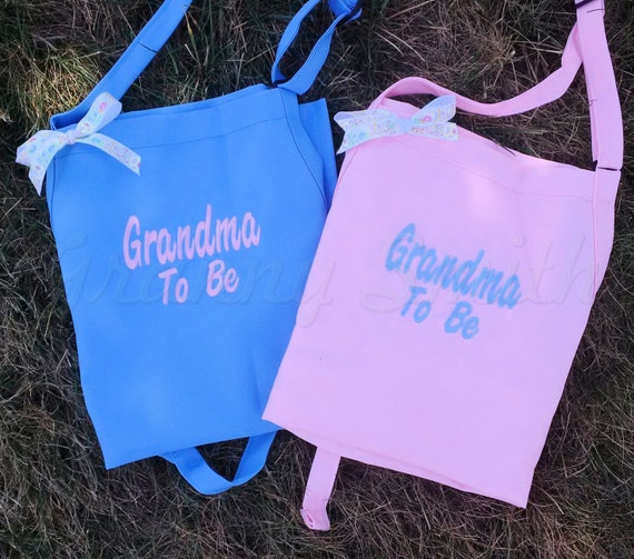 """GRANDMA TO BE Set of 2 Embroidered monogram 24""""L x 28""""W bib apron with 3 pockets.  Perfect for the gender reveal party!!!!"""