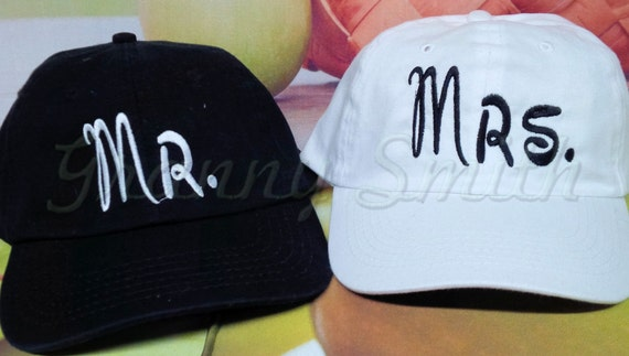 Set of 2 baseball caps / hats that match or are very similar with writing on the back as well!!!!
