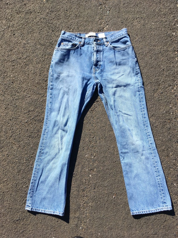 0c1f54ad304 SALE 31 90s boot cut jeans made in USA America American high