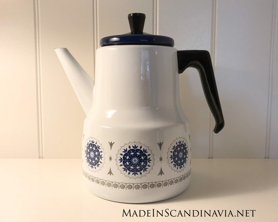 Vintage coffee pot in white and blue enamel