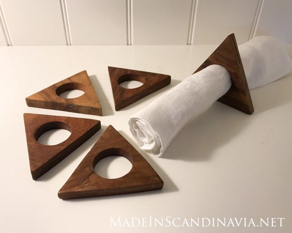 Mid-century collection of 5 triangular teak napkin rings and place setting holders