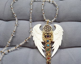 Priestess Necklace on Clear Crystal and Golden Hematite Beads - Flying Kundalini with Flower Of Life - Cast from Brass - White Bone Wings