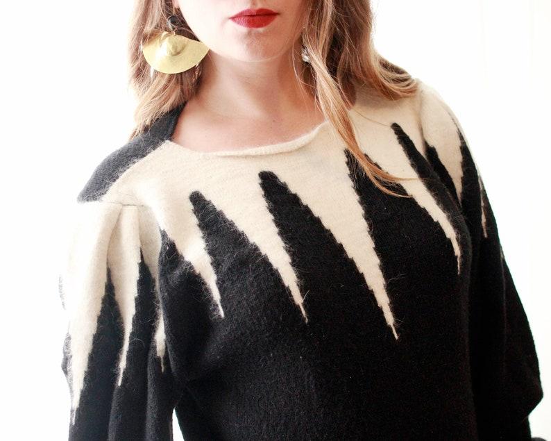 Vintage 1980s Geo novelty icicle chevron spike Tim Burton Nightmare Before Christmas print black cream white puff sleeve sweater dress 80s